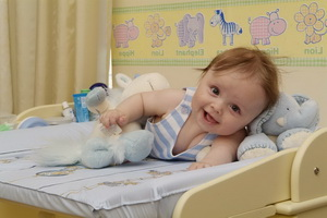 Ребенок в 7 месяцев: развивающие занятия, массаж и зарядка